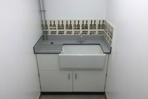 Belfast sink with white cupboards for Bedales School