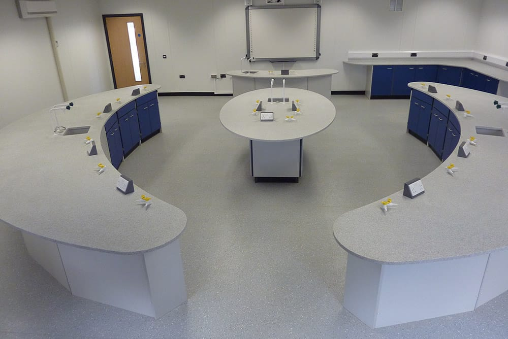 School lab furniture with curved Velstone worktop and blue doors
