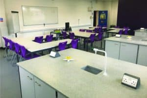 Science laboratory with Velstone worktops & purple feature wall