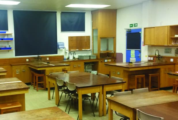 Before refurbishment – Wooden Iroko desks and workbenches