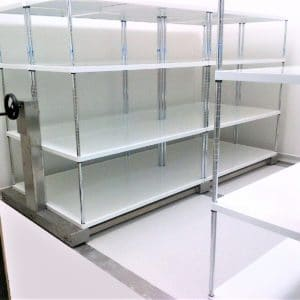 Stainless steel roller racking with powder coated shelving