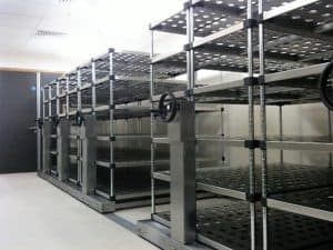 Perforated stainless steel racking on stainless steel roller racking.