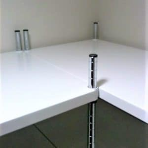 Mild steel powder coated shelving corner installation.