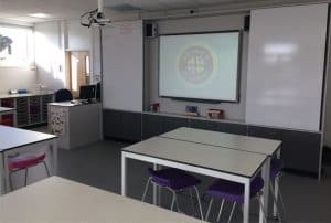 Penrice Academy classroom with teaching wall featuring whiteboards and interactive whiteboard