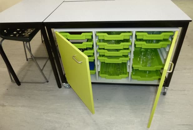 Science laboratory green storage unit with trays.