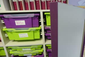 Storage room for secondary school with green and purple Gratnells' Trays