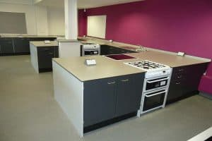 Southfield School food technology classroom with burgundy contrast wall.