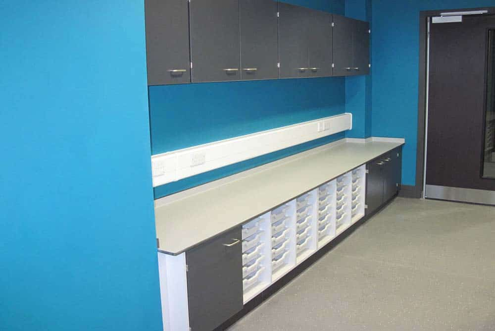 Southfield School classroom storage with blue contrast wall.