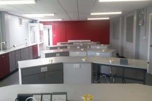Poynton High School science laboratory with red contrast wall.
