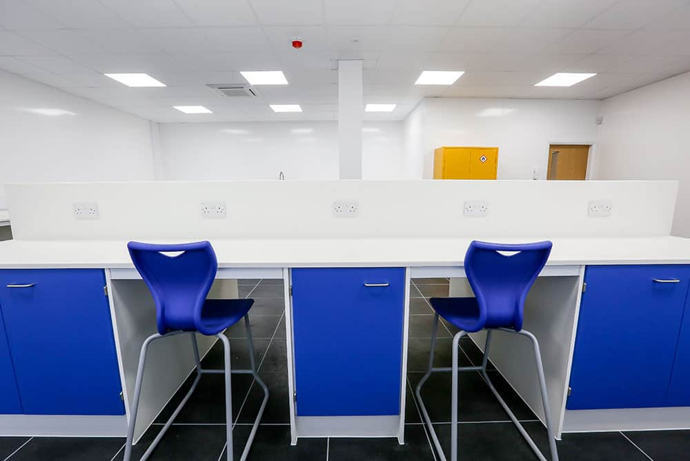 Pinmoore Animal Laboratory Velstone worktops with blue storage cabinets.