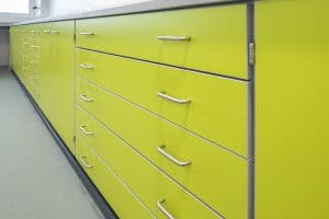 Callywith College benching with lime green storage draws.
