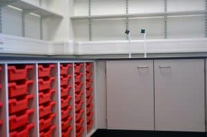 Bury College science laboratory prep room tray storage and sink.