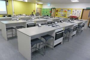 Prince Henry's Grammar School food technology classroom with yellow contrast wall.