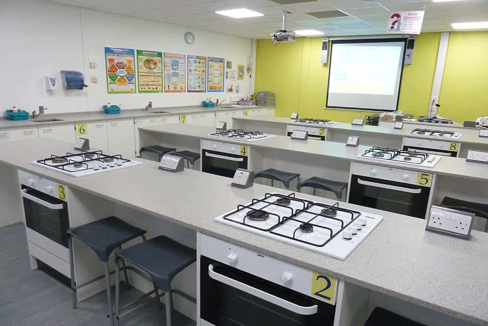 Prince Henry's Grammar School food tech classroom with yellow contrast wall.