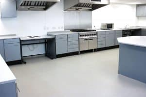 Heaton School food technology classroom with benching and fixed island bench.
