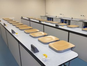 Balcarras School science lab furniture straight island layout with beech stools