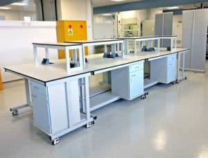 Mobile units with reagent shelving & power outlets for research lab.