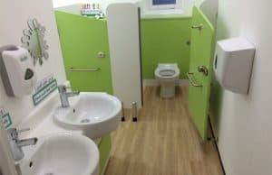 Primary school sink and toilet in a school washroom.