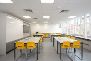Royal Ballet School science laboratory with loose tables and teaching wall