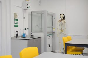 Science laboratory refurbishment with teacher's desk and fume cupboard