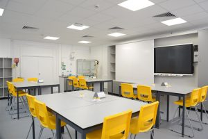 The Royal Ballet School science lab features Trespa tables and yellow stools