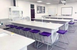 Large islands with Velstone worktops in school science laboratory.