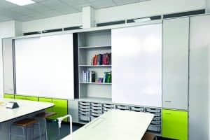 Teaching wall with sliding doors and tray storage