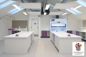 Tonbridge School science laboratory furniture with logo