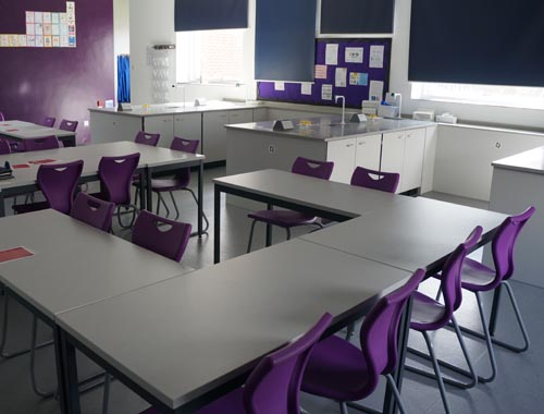 Chemistry lab theory area with co-ordinating purple chairs