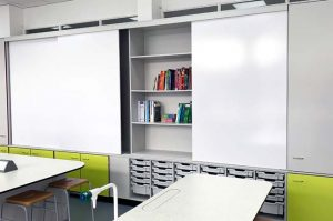 Teacher Wall design with shelving and sliding whiteboards