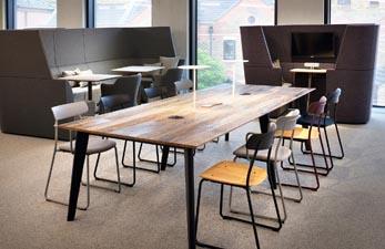 Mezzanine floor meeting table for breakout space